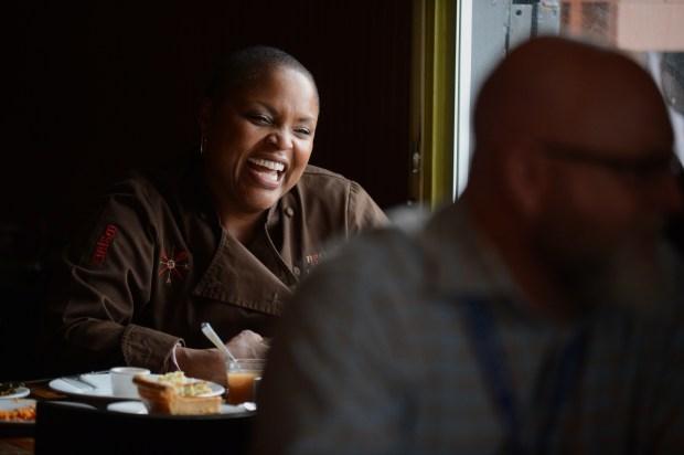 Tanya Holland shares a laugh at Brown Sugar Kitchen in Oakland, Calif., on Thursday, Oct. 23, 2014. (Dan Honda/Bay Area News Group)