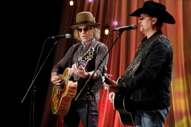 In this Dec. 13, 2016 file photo, Kenny Alphin, left, and John Rich, right, of the country music duo Big & Rich, perform a song during a taping for Dolly Parton's Smoky Mountain Rise Telethon in Nashville. The mass shooting at a country music festival on Oct. 1, 2017, has rocked the tight-knit community of country musicians, but even in the renewed debate about gun control, many of those musicians have not weighed in, with a few exceptions. Country duo Big & Rich, who have performed at NRA sponsored events, were at the festival just hours before the shooting started. They said it wasn't the weapons that were the problem, but the man using them. (AP Photo/Mark Humphrey, File)