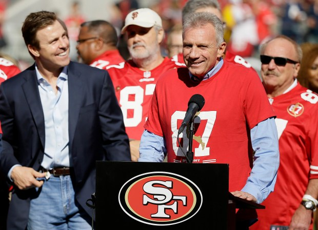 Pro football hall of famer Joe Montana speaks about former teammate Dwight Clark during halftime of an NFL football game between the San Francisco 49ers and the Dallas Cowboys in Santa Clara, Calif., Sunday, Oct. 22, 2017. (AP Photo/Eric Risberg)