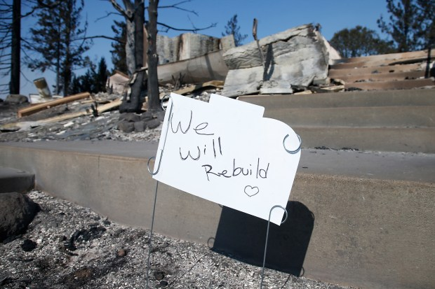 A sign of hope is planted in the ashes of a home consumed by the Tubbs fire on Rincon Ridge Drive in Santa Rosa, California, Thursday, October 12, 2017. (Karl Mondon/ Bay Area News Group)