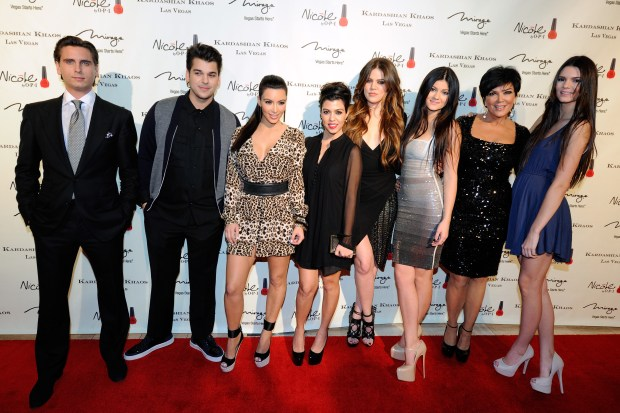 LAS VEGAS, NV - DECEMBER 15: (L-R) Television personalities Scott Disick, Robert Kardashian Jr., Kim Kardashian, Kourtney Kardashian, Khloe Kardashian, Kylie Jenner, Kris Jenner and Kendall Jenner arrive at the grand opening of the Kardashian Khaos store at The Mirage Hotel & Casino December 15, 2011 in Las Vegas, Nevada. (Photo by Ethan Miller/)