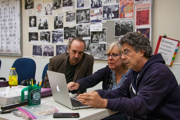 "Bennett S. Cohen, Lisa Peterson and Tony Taccone, from left, working on the premiere of ""It Can't Happen Here"" at Berkeley Rep. Cohen and Taccone wrote it, Peterson directed. (Nora Merecicky / Berkeley Rep)"