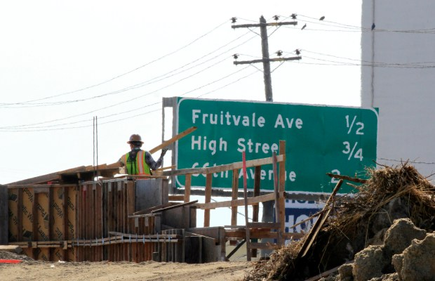 Work continues on the 23rd Avenue overpass at Highway 880 in Oakland, Calif., on Tuesday, Oct. 31, 2017. California drivers can expect more pain at the pump Wednesday as a new 12-cent gas tax goes into effect. The tax is expected to raise an extra $5 billion annually for highway maintenance and road repairs for local streets and roads.(Laura A. Oda/Bay Area News Group)