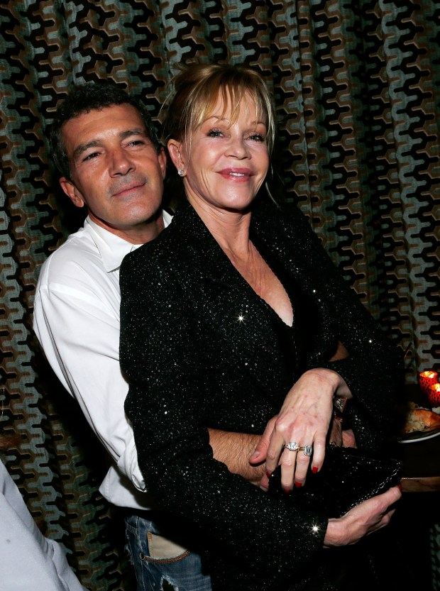 """NEW YORK, NY - NOVEMBER 18: (L-R) Actor Antonio Banderas and actress Melanie Griffith attend the after party for the """"Black Nativity"""" premiere at The Red Rooster on November 18, 2013 in New York City. (Photo by Jemal Countess/Getty Images)"""