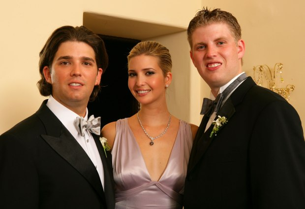 PALM BEACH, FL - NOVEMER 12: Donald Trump Jr. pose with his sister Ivanka Trump and brother Eric Trump after the wedding ceremony at the Mar-a-Lago Club November 12, 2005 in Palm Beach, Florida. (Photo by Carlo Allegri/Getty Images)