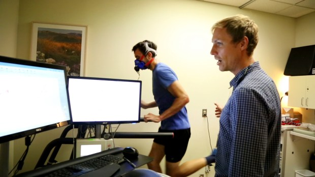 Dr. Mikael Mattsson, the lead investigator for the ELITE study, monitors the workout of Mikal Davis, a national-class duathlete from Redwood City at Stanford Medical Center in Stanford, Calif. on April, 25, 2017. Mattsson uses the treadmill test to identify athletes with freakishly high VO2 max scores, which indicate superior cardiovascular function.(Courtney Cronin, Bay Area News Group)