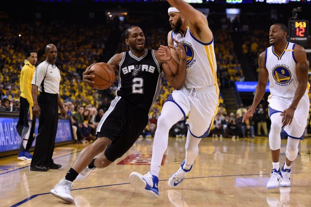 San Antonio Spurs' Kawhi Leonard (2) drives against Golden State Warriors' JaVale McGee (1) during the first quarter of Game 1 of the NBA Western Conference Finals at Oracle Arena in Oakland, Calif. on Sunday, May 14, 2017. (Jose Carlos Fajardo/Bay Area News Group)