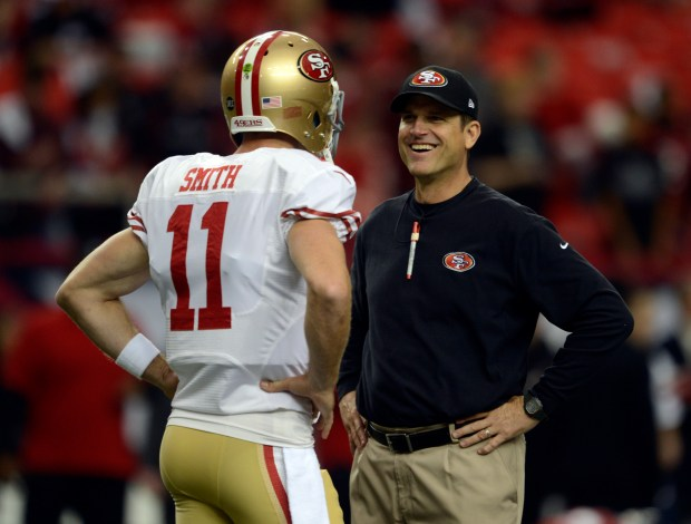 San Francisco 49ers head coach Jim Harbaugh laughs with quarterback Alex Smith (11) before playing the Atlanta Falcons in the NFC Championship game on Sunday, Jan. 20, 2013, at the Georgia Dome in Atlanta. (Jose Carlos Fajardo/Bay Area News Group)