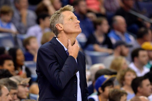 Golden State Warriors coach Steve Kerr stands on the sideline during the first half of the team's NBA basketball game against the Memphis Grizzlies on Saturday, Oct. 21, 2017, in Memphis, Tenn. (AP Photo/Brandon Dill)
