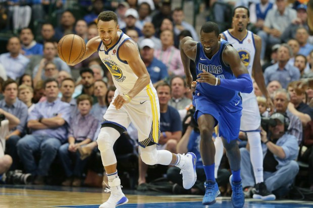 Golden State Warriors guard Stephen Curry (30) comes up with the loose ball against Dallas Mavericks forward Harrison Barnes (40) during the first half of an NBA basketball game in Dallas, Monday, Oct. 23, 2017. (AP Photo/LM Otero)