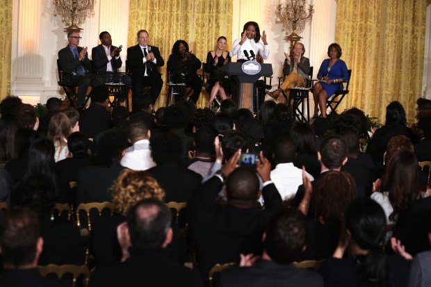 WASHINGTON, DC - NOVEMBER 08: U.S. first lady Michelle Obama speaks as (L-R) director David Frankel, director Ryan Coogler, production executive Harvey Weinstein, actress Whoopi Goldberg, actress Blake Lively, producer Bruce Cohen, and editor-at-large of The Oprah Magazine Gayle King listen during a workshop for high school students from DC, New York and Boston about careers in film production November 8, 2013 at the East Room of the White House in Washington, DC. Students had an opportunity to hear from leaders in the industry about animation, special effects, makeup, costume, directing, music and sound effects. (Photo by Alex Wong/Getty Images)