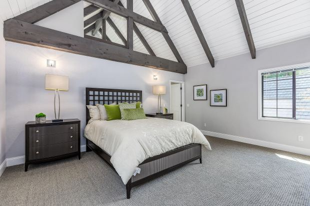 The redesigned and updated master bedroom retreat features a vaulted, exposed beam ceiling.
