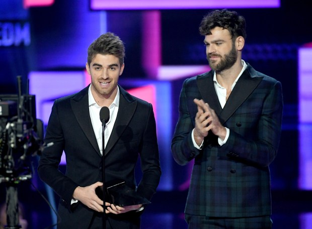 Andrew Taggart(L) and Alex Pall of music group The Chainsmokers accept the Favorite Artist - Electronic Dance Music (EDM) award onstage during the 2017 American Music Awards at Microsoft Theater on November 19, 2017 in Los Angeles, California. (Photo by Kevin Winter/Getty Images)