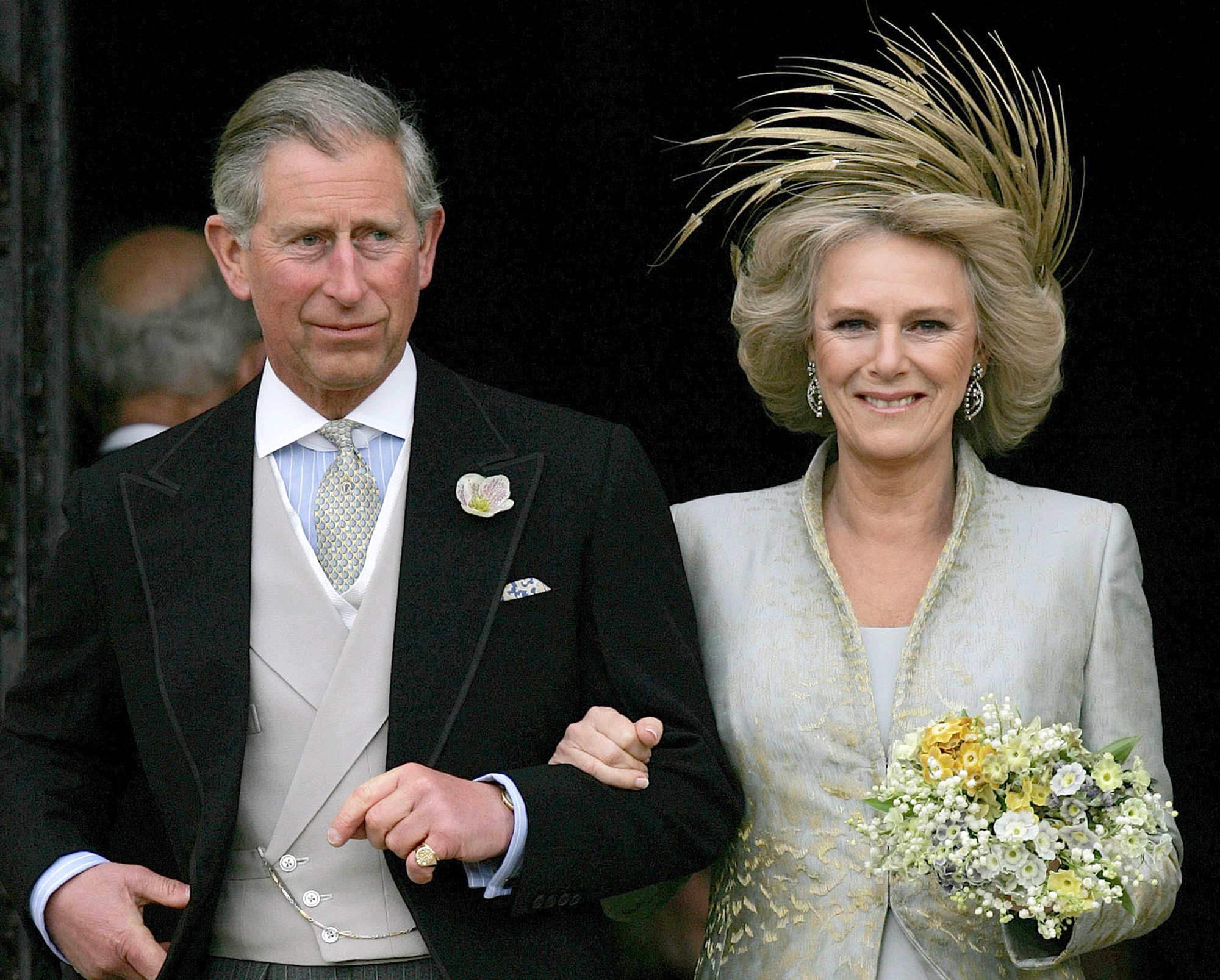 Britain's Prince Charles and his bride Camilla Duchess of Cornwall leave St George's Chaple in Windsor England following the church blessing of their civil wedding ceremony Saturday