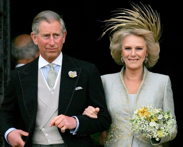 Britain's Prince Charles and his bride Camilla Duchess of Cornwall leave St George's Chaple in Windsor, England following the church blessing of their civil wedding ceremony, Saturday, April 9, 2005. (AP Photo/ Alastair Grant, Pool)