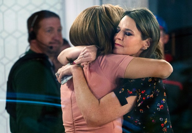 "Co-anchors Hoda Kotb, left, and Savannah Guthrie embrace on the set of the ""Today"" show Wednesday, Nov. 29, 2017, in New York, after NBC News fired host Matt Lauer. NBC News announced Wednesday that Lauer was fired for ""inappropriate sexual behavior."" (AP Photo/Craig Ruttle)"