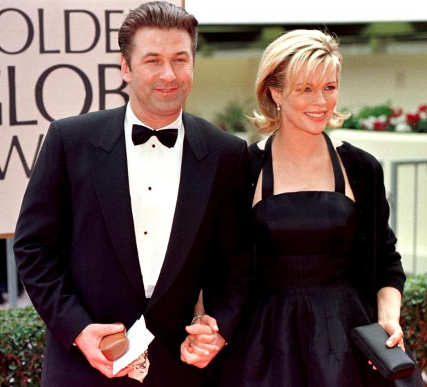 """BEVERLY HILLS, CA - JANUARY 18: Actress Kim Basinger (R) arrives with her husband actor Alec Baldwin (L) for the 55th Annual Golden Globe Awards at the Beverly Hilton 18 January in Beverly Hills, CA. Basinger won Best Supporting Actress in the drama category for her role in """"L.A. Confidential"""". AFP PHOTO Hal GARB/mn (Photo credit should read HAL GARB/AFP/Getty Images)"""
