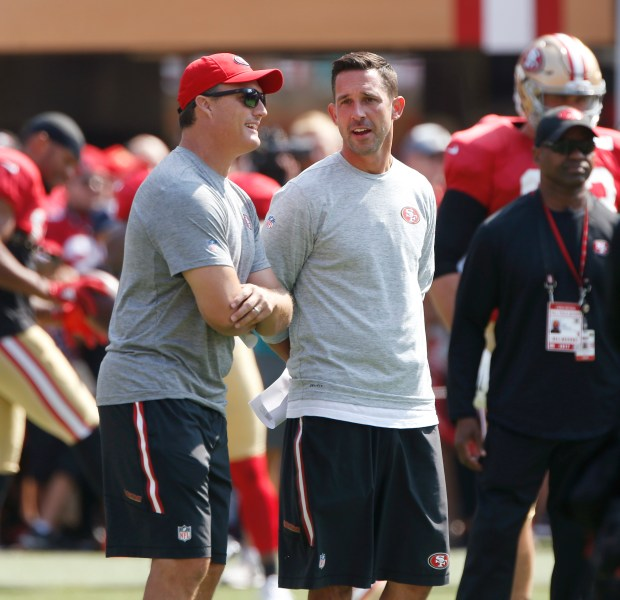 John Lynch, 49ers general manager, at left, and Kyle Shanahan, 49ers head coach, talk during San Francisco 49ers practice at Levi's Stadium on Saturday, Aug. 5, 2017, in Santa Clara, Calif. (Jim Gensheimer/Bay Area News Group)