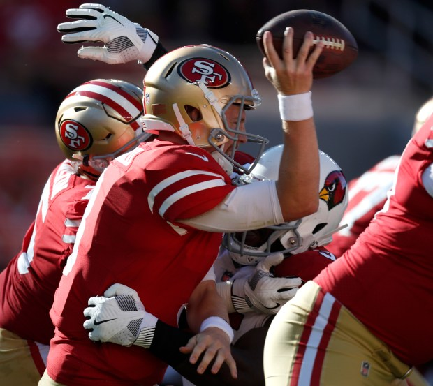 San Francisco 49ers starting quarterback C.J. Beathard (3) is sacked by Arizona Cardinals' Rodney Gunter (95) in the second quarter of their NFL game at Levi's Stadium in Santa Clara, Calif. on Sunday, Nov. 5, 2017. (Nhat V. Meyer/Bay Area News Group)