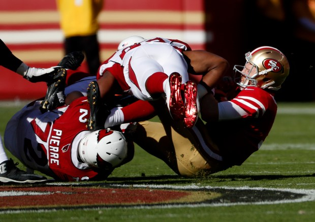 Arizona Cardinals' Olsen Pierre (72) and Arizona Cardinals' Haason Reddick (43) sack the San Francisco 49ers starting quarterback C.J. Beathard (3) in the first quarter of their NFL game at Levi's Stadium in Santa Clara, Calif. on Sunday, Nov. 5, 2017. (Josie Lepe/Bay Area News Group)