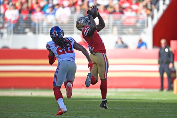 San Francisco 49ers' Marquise Goodwin (11) reaches back to catch a touchdown pass in front of New York Giants' Janoris Jenkins (20) during the second quarter of their NFL game at Levi's Stadium in Santa Clara, Calif., on Sunday, Nov. 12, 2017. (Jose Carlos Fajardo/Bay Area News Group)
