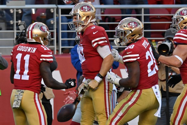 San Francisco 49ers quarterback C.J. Beathard (3) celebrates with his teammates after scoring a touchdown against the New York Giants during the fourth quarter of their NFL game at Levi's Stadium in Santa Clara, Calif., on Sunday, Nov. 12, 2017. San Francisco defeated New York 31-21. (Jose Carlos Fajardo/Bay Area News Group)
