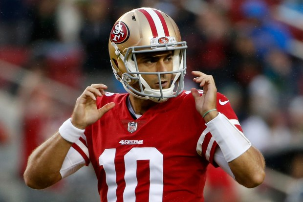 Jimmy Garoppolo (10) makes his first game appearance as the San Francisco 49ers quarterback entering the game late in the fourth quarter the Seattle Seahawks after starting quarterback C.J. Beathard was injured in an NFL game at Levi's Stadium in Santa Clara, Calif., Sunday, November 26, 2017. (Karl Mondon/Bay Area News Group)