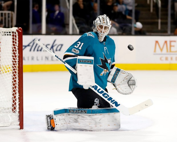 San Jose Sharks' Martin Jones (31) keeps an eye on the puck after making a save against the Tampa Bay Lightning in the second period of their NHL game at SAP Center in San Jose, Calif. on Wednesday, November 8, 2017. (Josie Lepe/Bay Area News Group)