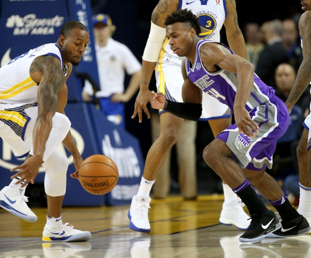 Golden State Warriors' Andre Iguodala (9) scrambles for a loose ball with Sacramento Kings' Buddy Hield (24) in the second quarter of their game at Oracle Arena in Oakland, Calif., on Monday, Nov. 27, 2017. (Jane Tyska/Bay Area News Group)