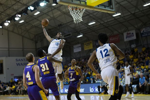 Damian Jones soars for a dunk in the Santa Cruz Warriors' home opener against Los Angeles.
