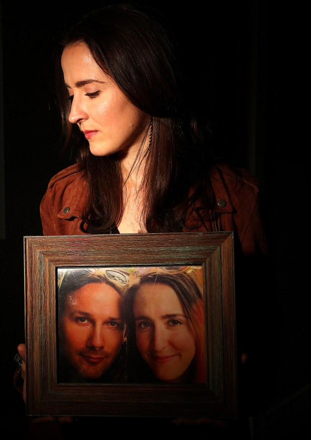 Louisa Lemauviel is photographed with a picture of her fiancee Travis Hough on Tuesday, Nov. 07, 2017, in Oakland, Calif. Hough died in the Ghost Ship warehouse fire. (Aric Crabb/Bay Area News Group)