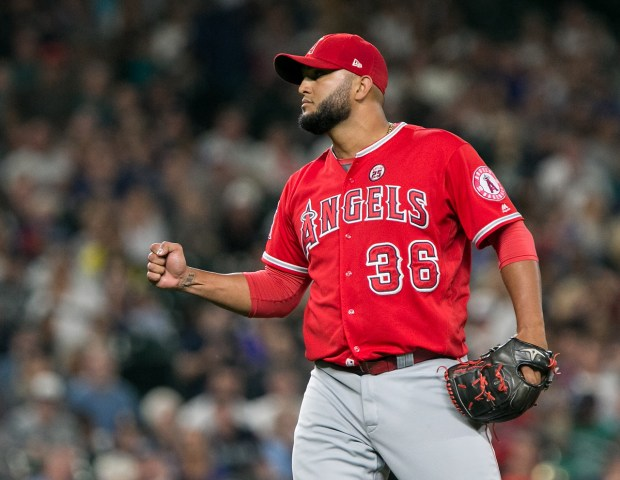 Yusmeiro Petit #36 of the Los Angeles Angels of Anaheim celebrates closing out the game to beat the Seattle Mariners 6-5 in the ninth inning at Safeco Field on August 11, 2017 in Seattle, Washington. (Lindsey Wasson/Getty Images)
