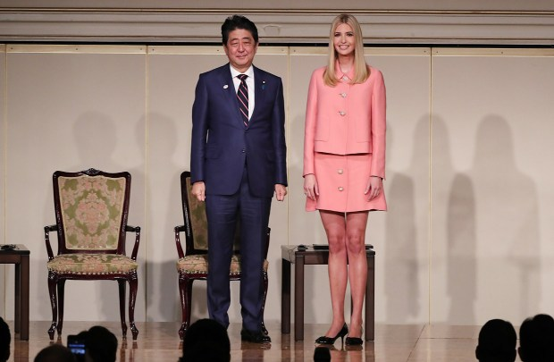 Ivanka Trump, the daughter and assistant to US President Donald Trump, right, and Japanese Prime Minister Shinzo Abe, left, stand together at the World Assembly for Women (WAW!) in Tokyo on November 3, 2017.Ivanka Trump spoke at the World Assembly for Women in the Japanese capital ahead of her father's presidential visit. / AFP PHOTO / POOL / Eugene Hoshiko (Photo credit should read EUGENE HOSHIKO/AFP/Getty Images)