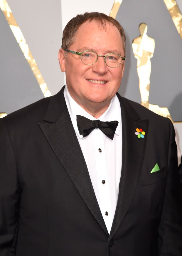 """FILE - In this Feb. 28, 2016 file photo, Pixar co-founder and Walt Disney Animation chief John Lasseter arrives at the Oscars in Los Angeles. Lasseter is taking a six-month leave of absence citing """"missteps"""" with employees. (Photo by Dan Steinberg/Invision/AP, File)"""