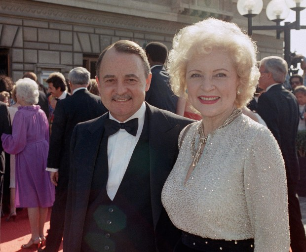 1985: John Hillerman and Betty White arriving at Emmy Awards in Pasadena, Calif.(AP Photo/LIU, File)
