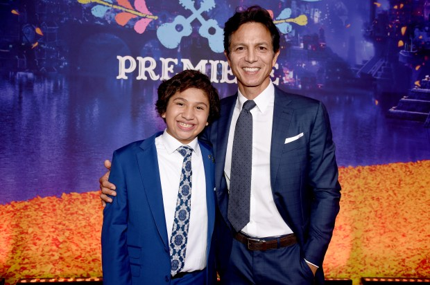 """Actors Anthony Gonzalez (L) and Benjamin Bratt arrive at the premiere of Disney Pixar's """"Coco"""" at the El Capitan Theatre on November 8, 2017 in Los Angeles, California. (Photo by Kevin Winter/Getty Images)"""