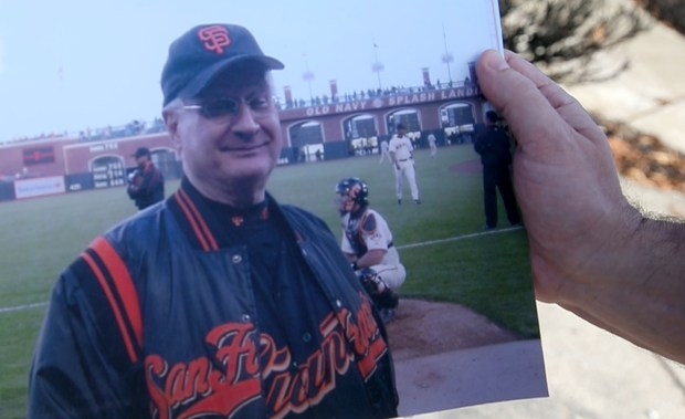 Steve Pletkin holds a photo of his late father Alex Pletkin taken when he was a ball dude at AT&T Park. Steve helped his mother Millie Pletkin recover the urn filled with with Alex's ashes from the rubble of her Santa Rosa, California home, destroyed in the Tubbs Fire last month. The Pletkins returned to the family's Fountaingrove home, Tuesday, November 14, 2017. (Karl Mondon/Bay Area News Group)
