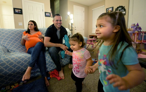 Avery, 1, and Savannah, 3, play in the living room as their parents Amy Kempel, and Chad Kempel, talk about wanting Kaiser, their healthcare provider, to allow Amy, who is pregnant with quintuplets, to go out of network to a doctor in Arizona during an interview at their home in Mountain House, Calif., on Tuesday, Nov. 21, 2017. Amy's pregnancy is considered high-risk, and the out of network doctor has successfully helped quint families deliver healthy babies. The couple, who lost twins in 2013, argue Kaiser has no history of successfully caring for moms and babies in quintuplet pregnancies. (Doug Duran/Bay Area News Group)