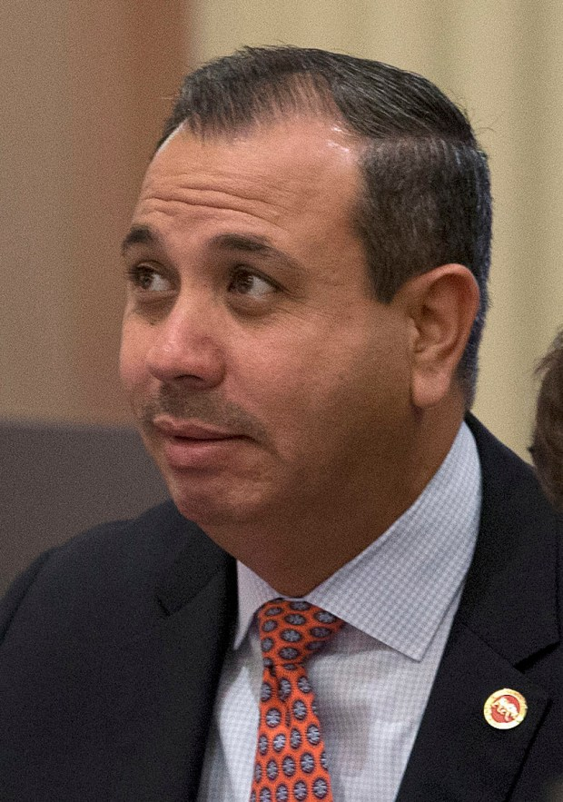 State Sen. Tony Mendoza, D-Artesia, watches as the votes are posted for his school bus safety measure, Friday, Aug. 26, 2016, in Sacramento, Calif. Amid a continued outcry over the treatment of women in California's Capitol, allegations have surfaced that in late August a Los Angeles-area Democrat, Sen. Tony Mendoza repeatedly invited a young woman - who was seeking a job in his office - back to his Sacramento-area apartment. The next month, three of Mendoza's staffers who knew about or reported the allegations to the Senate Rules Committee were fired, The Sacramento Bee reported. (AP Photo/Rich Pedroncelli)