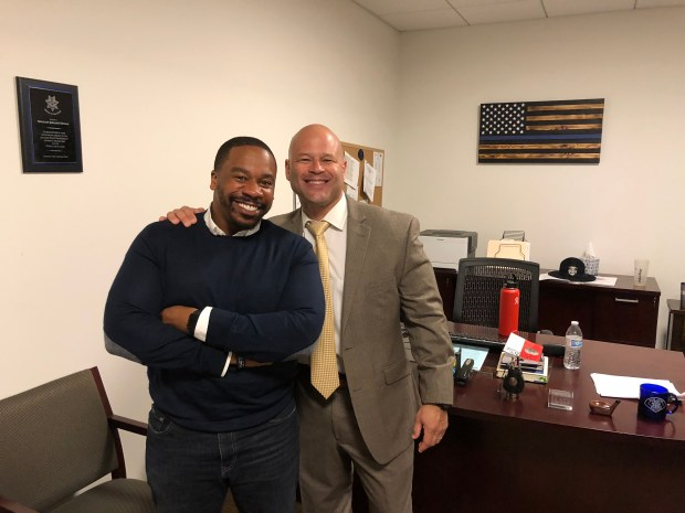 Pastor Jason Reynolds, left, of the Emmanuel Baptist Church in San Jose, and San Jose police Chief Eddie Garcia pose for a photograph Nov. 19, 2017 at the SJPD substation, where the department hosted the church's Sunday service in a show of unity between officers and community members who have been vocal about police accountability. (San Jose Police Dept.)