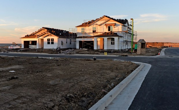 New homes under construction in KB Homes' Montevello development are photographed in Stockton, Calif., on Wednesday, Nov. 29, 2017. New data from the Federal Housing Finance Agency shows that Stockton is on the top of the list of the country's 100 biggest metropolitan areas where home prices have increased. Experts say that's in part because Bay Area residents are fleeing the area and seeking out cities with cheaper homes, driving up prices. (Doug Duran/Bay Area News Group)