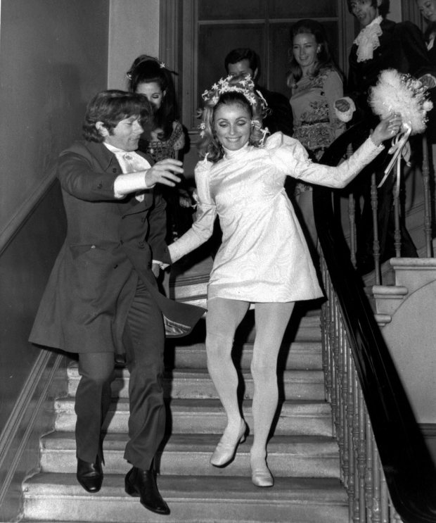 American actress Sharon Tate and Polish born film director Roman Polanski skip downstairs after their wedding at Chelsea Registery Office, London in Jan. 20, 1968. (AP Photo)