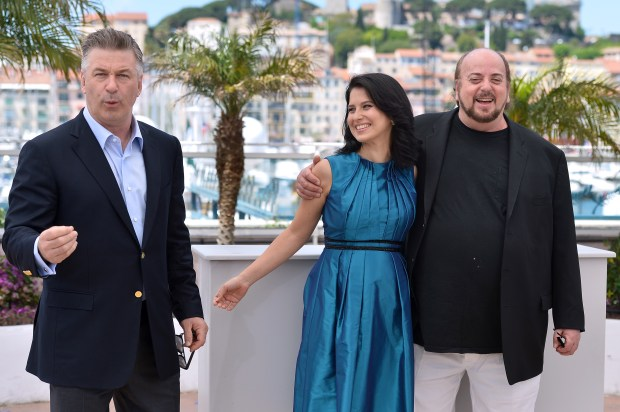 """US actor Alec Baldwin (L) poses on May 21, 2013 with his wife Hilaria Thomas (C) and director James Toback during a photocall for the film """"Seduced and Abandoned"""" presented Out of Competition at the 66th edition of the Cannes Film Festival in Cannes. Cannes, one of the world's top film festivals, opened on May 15 and will climax on May 26 with awards selected by a jury headed this year by Hollywood legend Steven Spielberg. AFP PHOTO / ALBERTO PIZZOLI (Photo credit should read ALBERTO PIZZOLI/AFP/Getty Images)"""