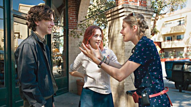 "BEST DIRECTOR -- Greta Gerwig, right (with Timothée Chalamet and Saoirse Ronan), ""Lady Bird."" (A24)"