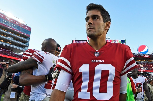 San Francisco 49ers quarterback Jimmy Garoppolo (10) walks on the field after defeating the New York Giants during their NFL game at Levi's Stadium in Santa Clara, Calif., on Sunday, Nov. 12, 2017. San Francisco defeated New York 31-21. (Jose Carlos Fajardo/Bay Area News Group)