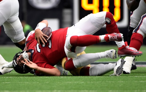 Houston Texans quarterback Tom Savage (3) is sacked by San Francisco 49ers outside linebacker Eli Harold (57) during the first half of an NFL football game, Sunday, Dec. 10, 2017, in Houston. (AP Photo/Eric Christian Smith)