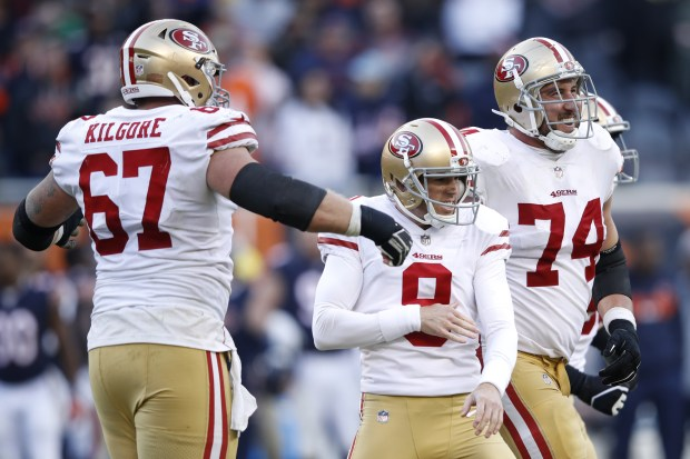 CHICAGO, IL - DECEMBER 03: Kicker Robbie Gould #9 of the San Francisco 49ers celebrates with teammates, including Joe Staley #74, after scoring the game winning field goal against the Chicago Bears in the fourth quarter at Soldier Field on December 3, 2017 in Chicago, Illinois. The San Francisco 49ers defeated the Chicago Bears 15-14. (Photo by Joe Robbins/Getty Images)