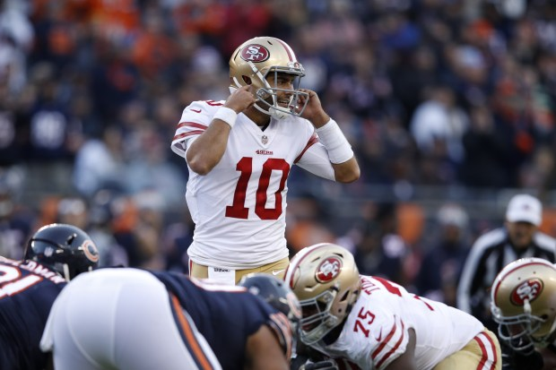 CHICAGO, IL - DECEMBER 03: Quarterback Jimmy Garoppolo #10 of the San Francisco 49ers prepares for the snap in the fourth quarter against the Chicago Bears at Soldier Field on December 3, 2017 in Chicago, Illinois. The San Francisco 49ers defeated the Chicago Bears 15-14. (Photo by Joe Robbins/Getty Images)