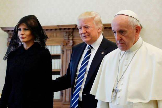Pope Francis (R) walks along with US President Donald Trump and US First Lady Melania Trump during a private audience at the Vatican on May 24, 2017. US President Donald Trump met Pope Francis at the Vatican today in a keenly-anticipated first face-to-face encounter between two world leaders who have clashed repeatedly on several issues. / AFP PHOTO / POOL / Evan VucciEVAN VUCCI/AFP/Getty Images