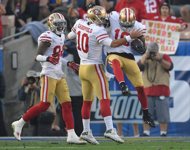 San Francisco 49ers wide receiver Aldrick Robinson, right, celebrates after scoring with quarterback Jimmy Garoppolo during the second half of an NFL football game against the Los Angeles Rams Sunday, Dec. 31, 2017, in Los Angeles. (AP Photo/Mark J. Terrill)